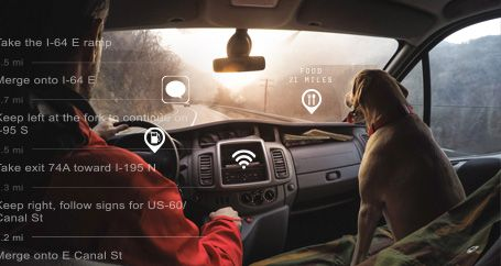 Male driver in car with dog following GPS navigation