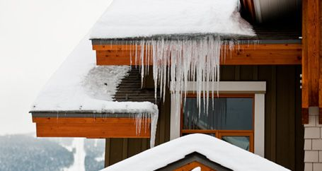 Icicles and snow on roof of home