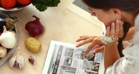 Female homeowner browsing kitchen fixtures online