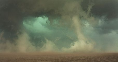 Tornado touching down at night