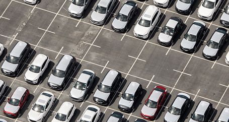 New cars parked on dealer lot