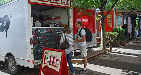 Customers buying lunch at food truck
