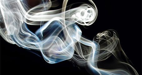 Smoke drifting from fire at night