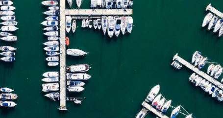 Recreational boats and watercraft docked at marina