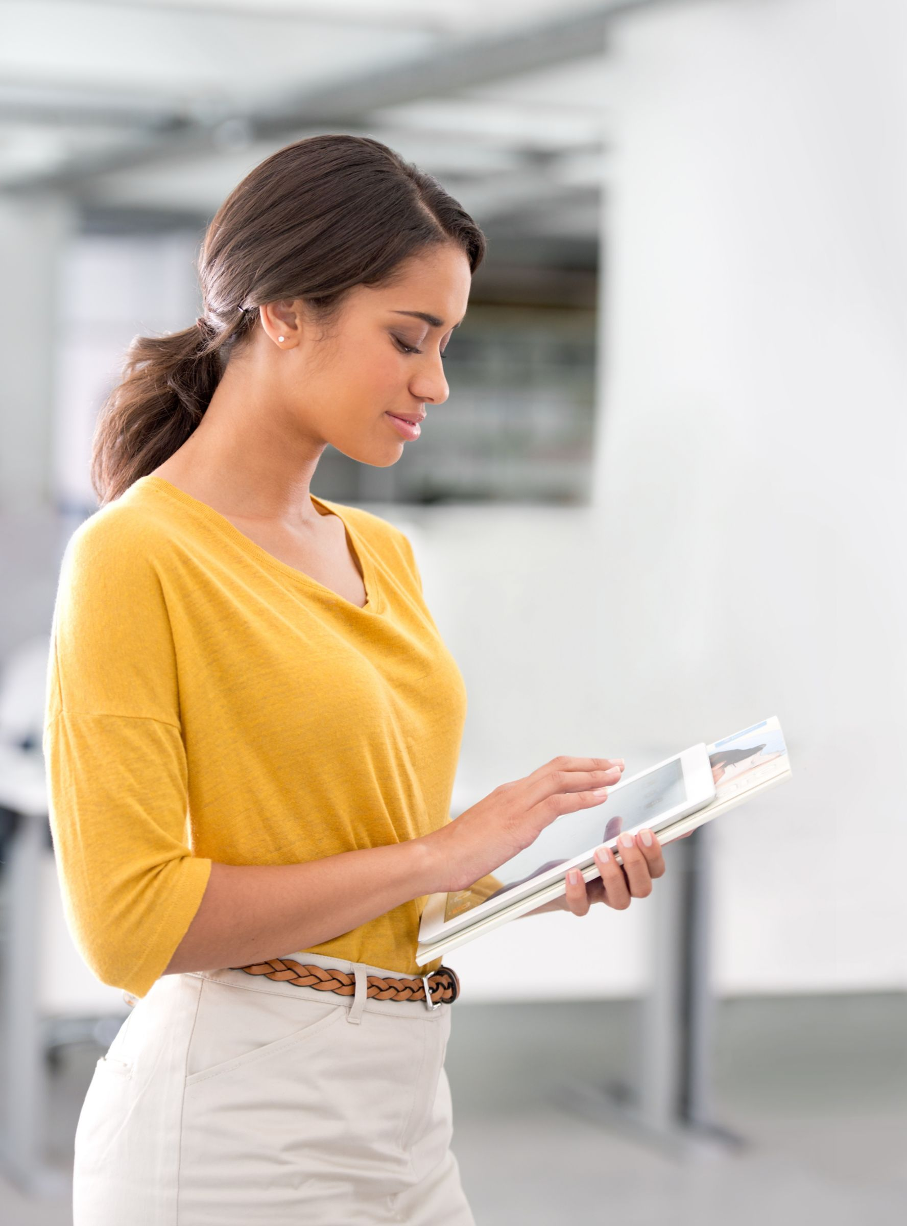 woman engaging with tablet