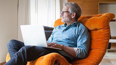 Saving for Retirement Blog Man in Orange Chair