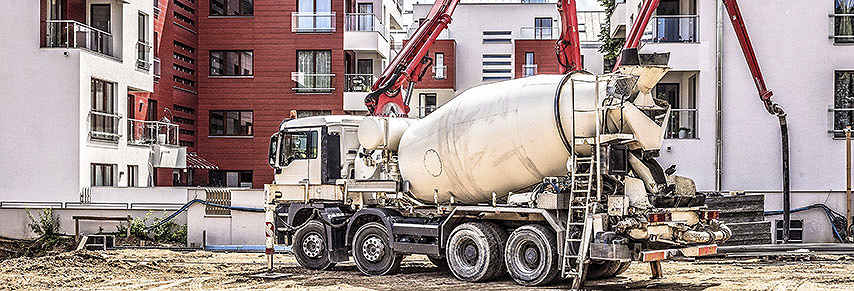 Cement Truck pumping cement on a construction site