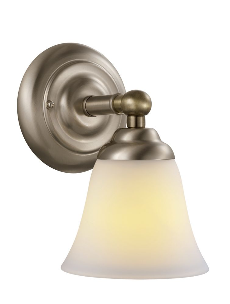 Bliss Satin Nickel Wall Sconce with Antique Brass Accents.