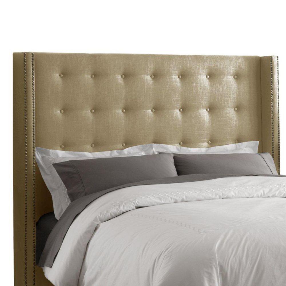 Tête de très grand lit étroit capitonnée en lin de ton grès enjolivée de têtes de clous en laiton