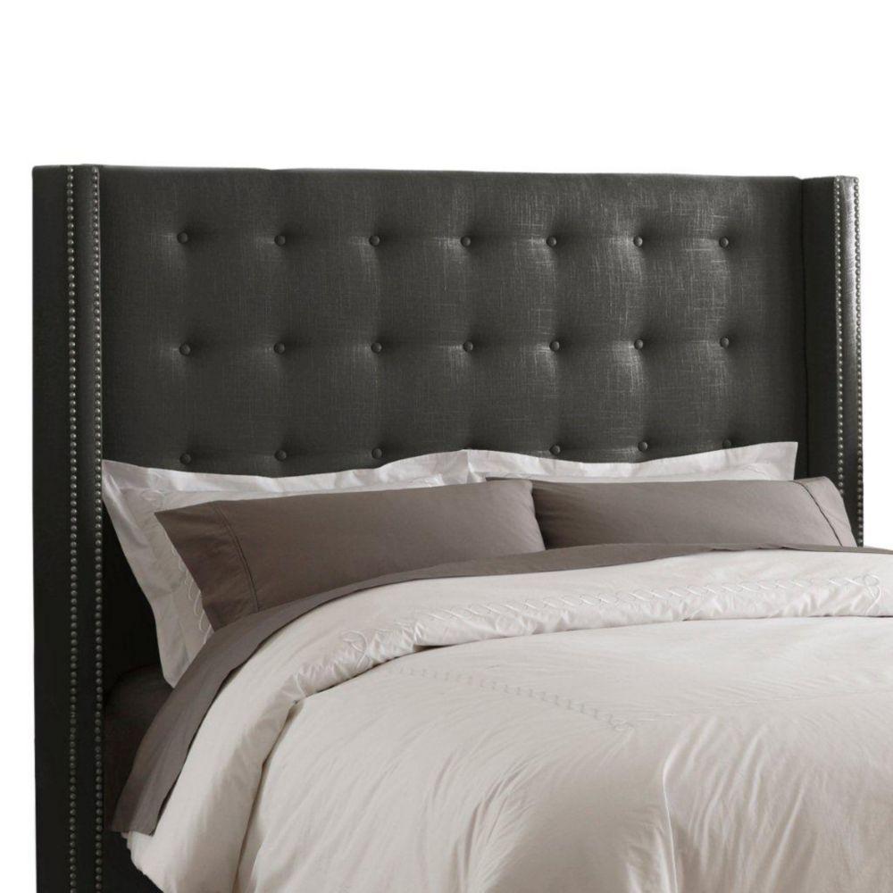 Tête de lit double capitonnée en lin de ton charbon enjolivée de têtes de clous en laiton