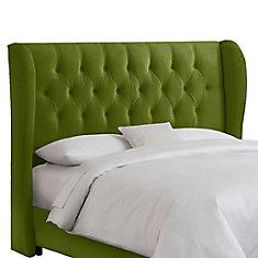 Tête de grand lit capitonnée à oreilles en velours de ton vert pomme
