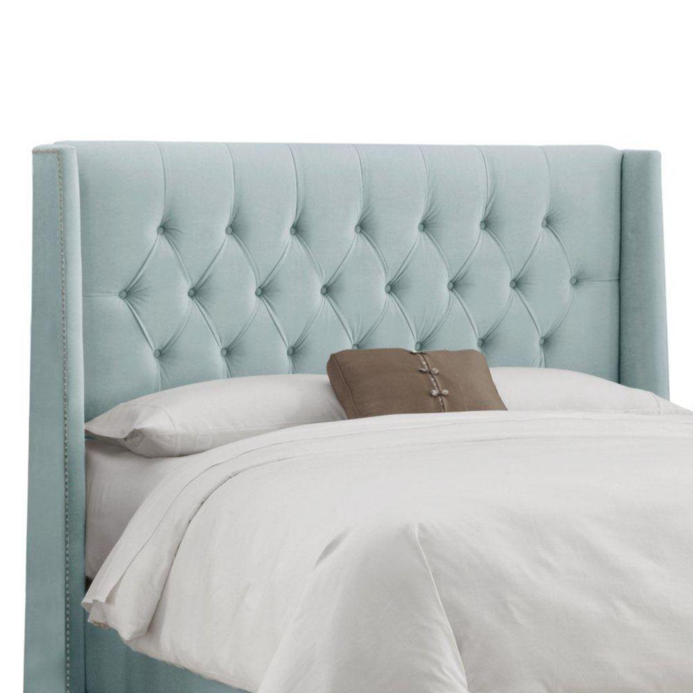 Dossier capitonné pour grand lit en velours de ton bleu pale