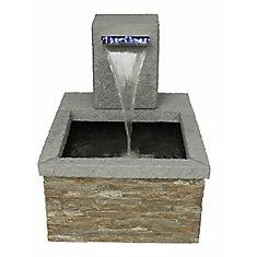 Bassin de patio en pierre avec déversoir illuminé