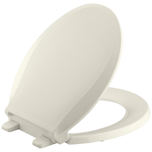 Cachet Quiet-Close Round Front Closed-Front Toilet Seat with Grip-Tight Bumpers in Biscuit