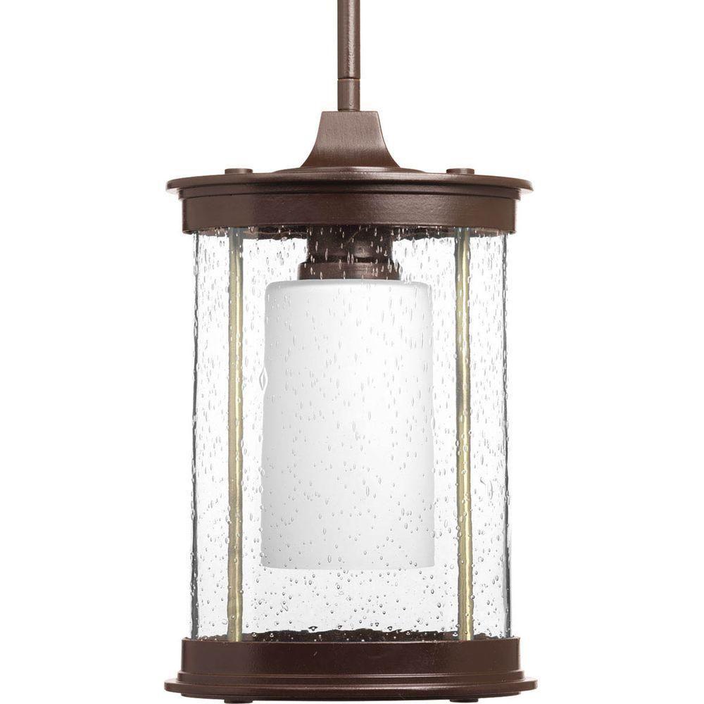Peek-a-boo Collection Antique Bronze 1-light Wall Lantern