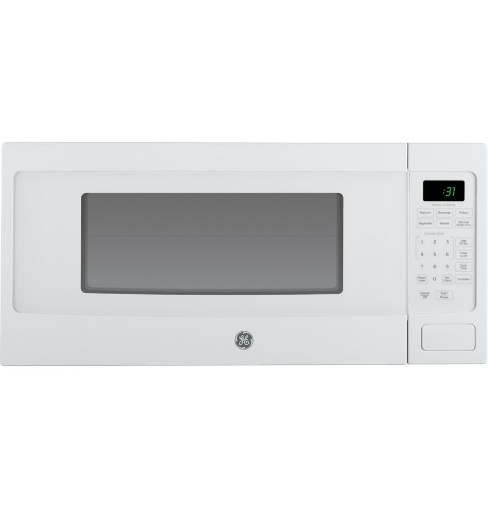 GE 1.1 cu. ft. SpaceMaker Microwave Oven in White | The Home Depot ...