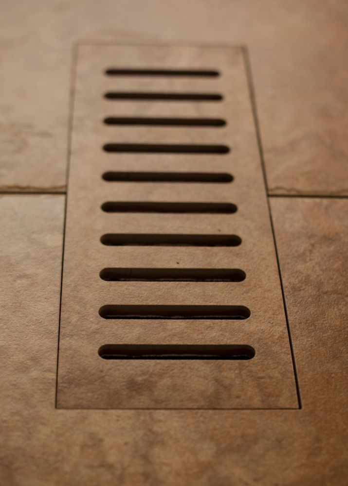 Porcelain vent cover made to match Lancaster Brown tile. Size - 5 Inch x 11 Inch