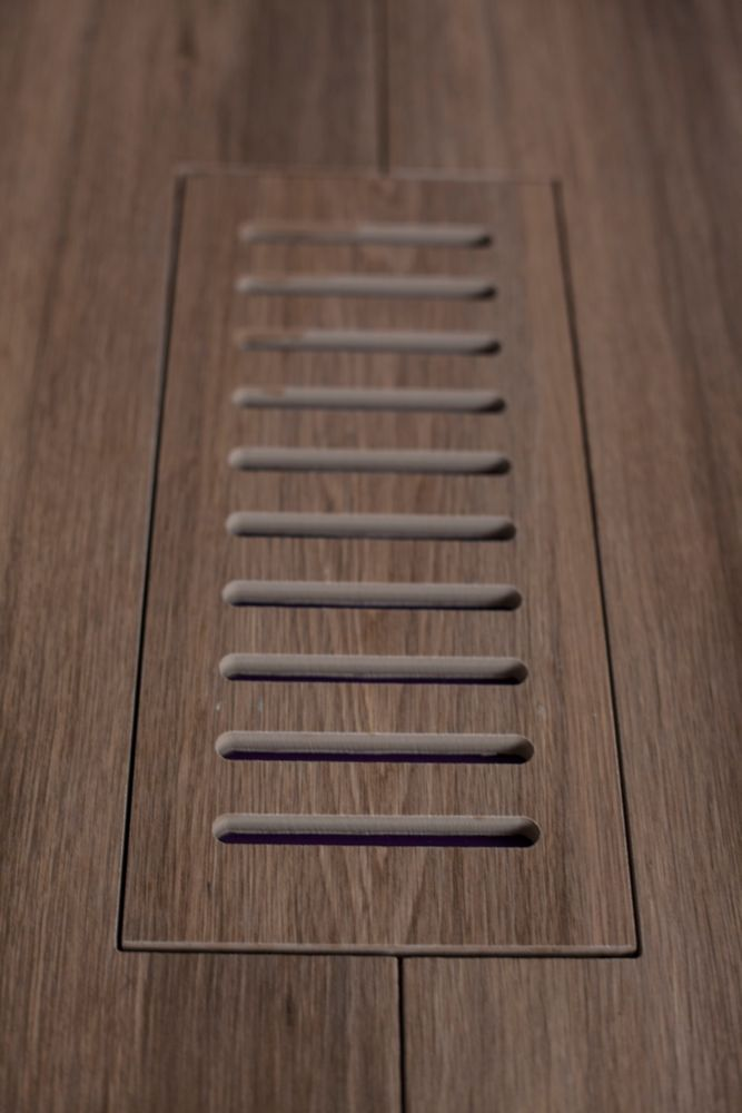 Porcelain vent cover made to match Corte Walnut Plank tile. Size - 4 Inch x 11 Inch