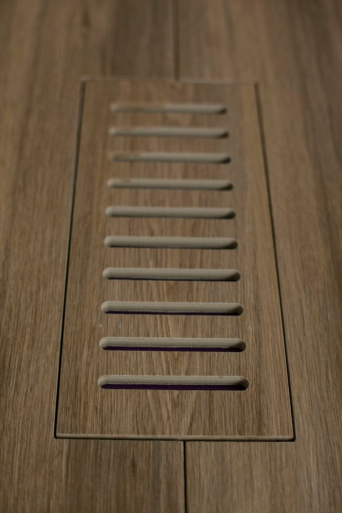 Porcelain vent cover made to match Corte Aged Teak Plank tile. Size - 4-inch x 11-inch
