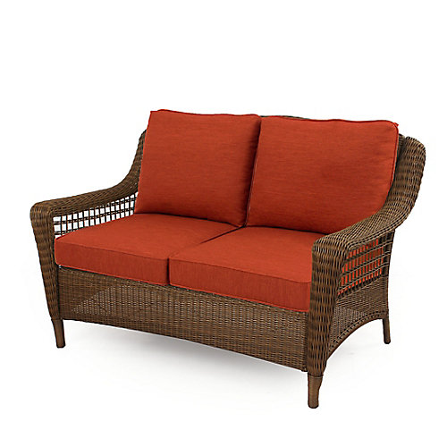 Spring Haven Brown Wicker Loveseat w/ Orange Cushion