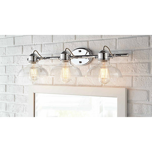 Delacorte 3 light bathroom vanity light fixture in chrome with clear glass shades
