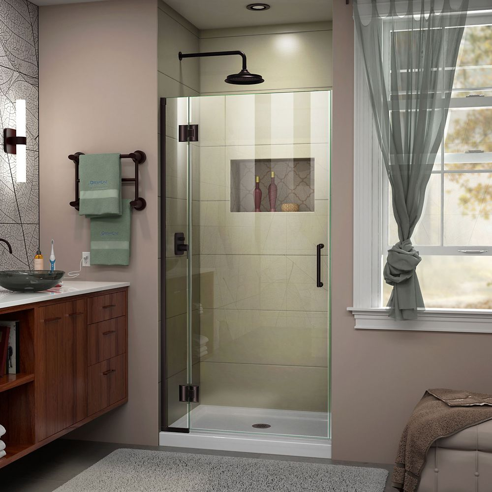 Unidoor-X 33-inch x 72-inch Frameless Rectangular Pivot/Hinged Clear Shower Door with Bronze Accents