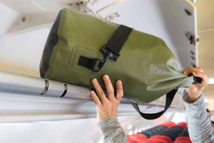 Passenger putting luggage in locker