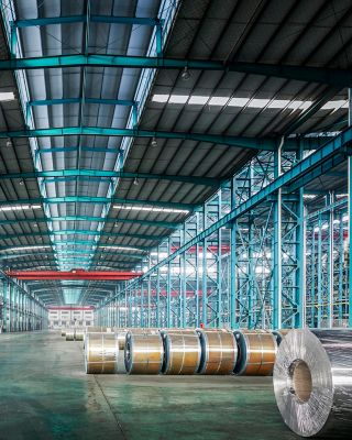 Packed coils of steel sheet in a plant, china.