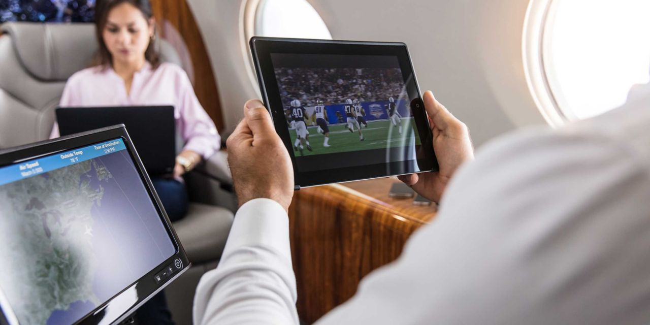 Passenger using iPad in Cabin