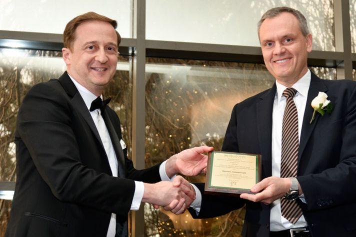 hon-ab_darius-adamczyk-with-msu-alumni-award-jpg-jpg.jpg