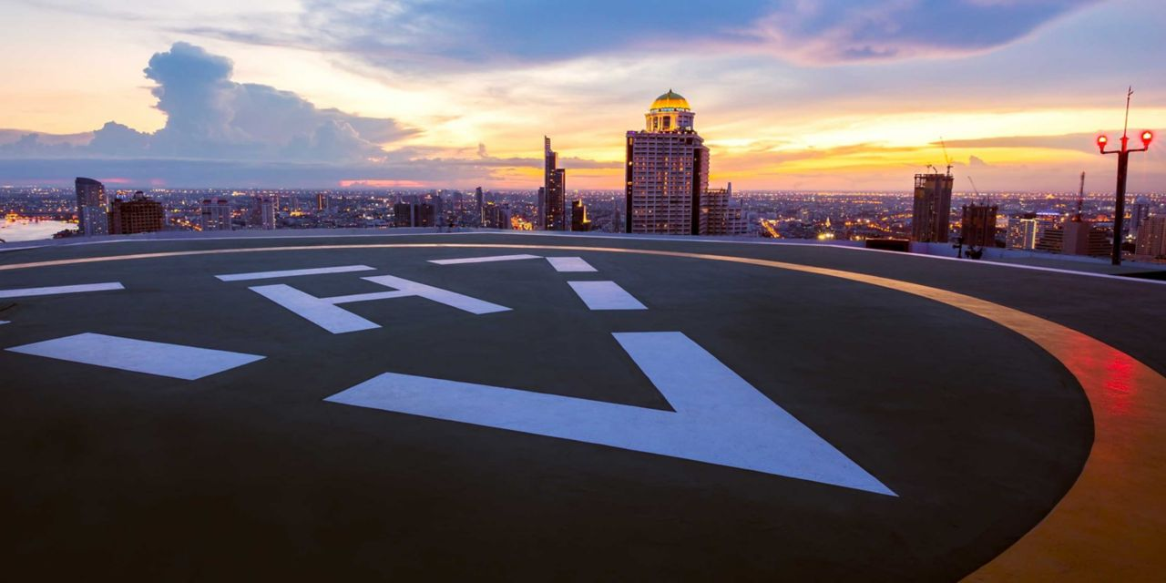 Helipad on rooftop at sunset