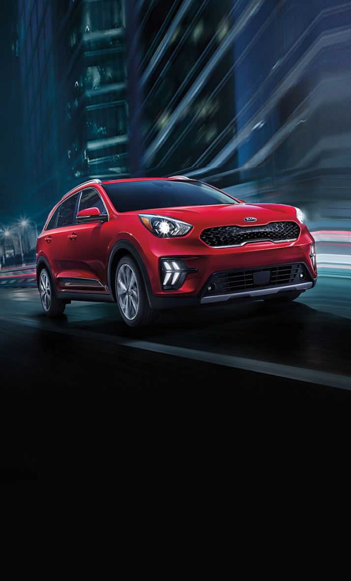 2021 Kia Niro Plug-In Hybrid Driving At Night In The City Three-Quarter View