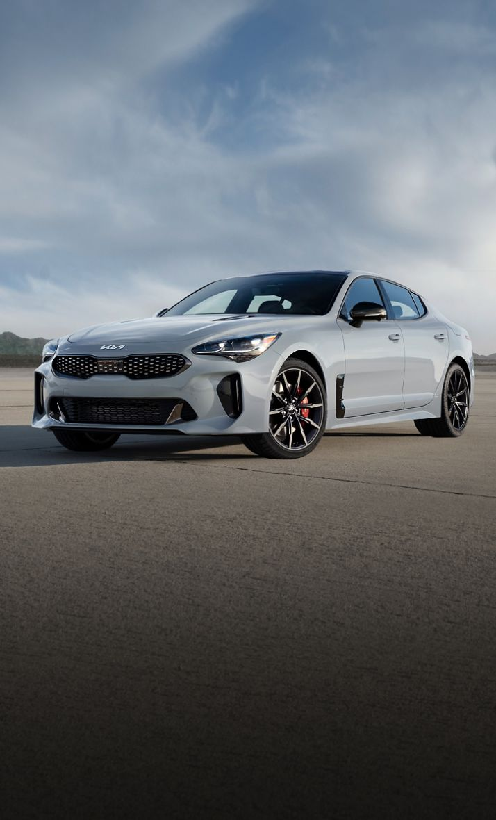 2022 Kia Stinger Parked In Front Of A Mountain Three-Quarter View