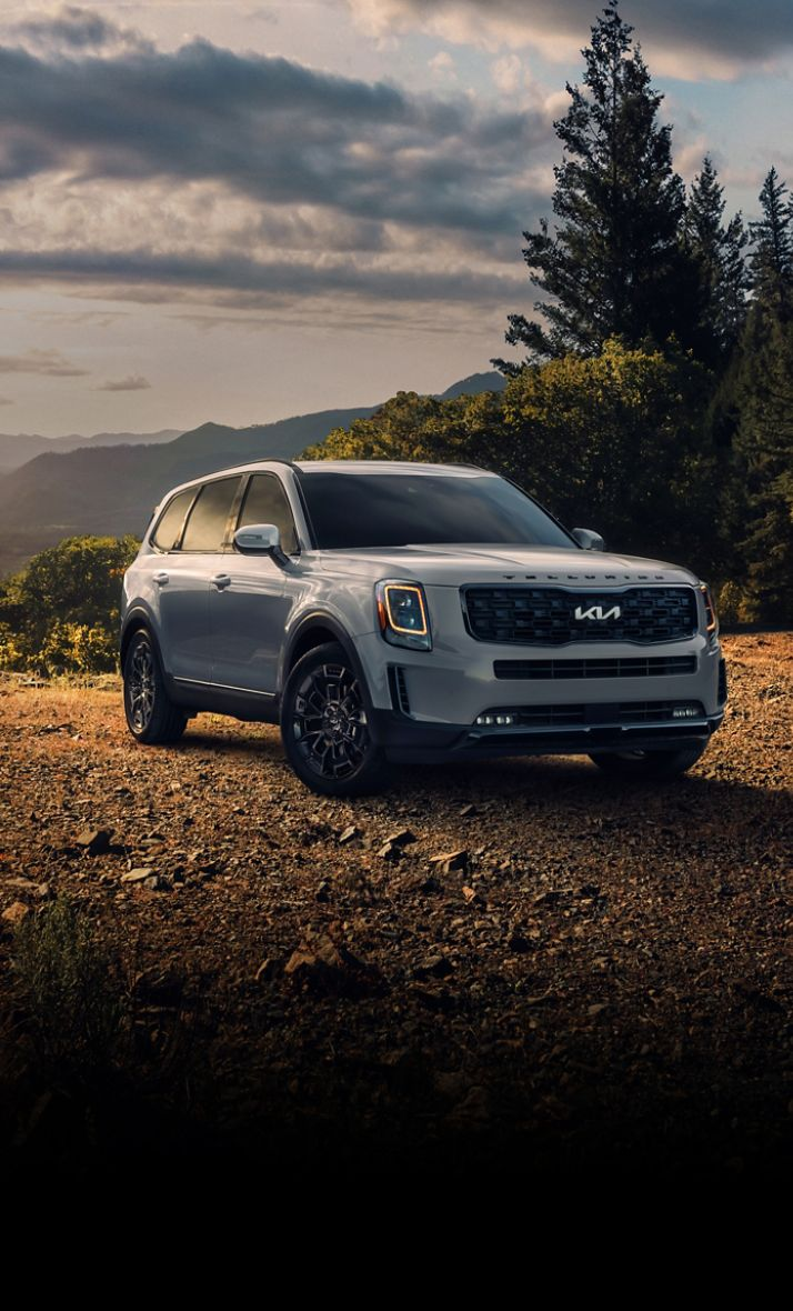 2022 Kia Telluride Parked In Front Of Mountains During Sunrise Three-Quarter View