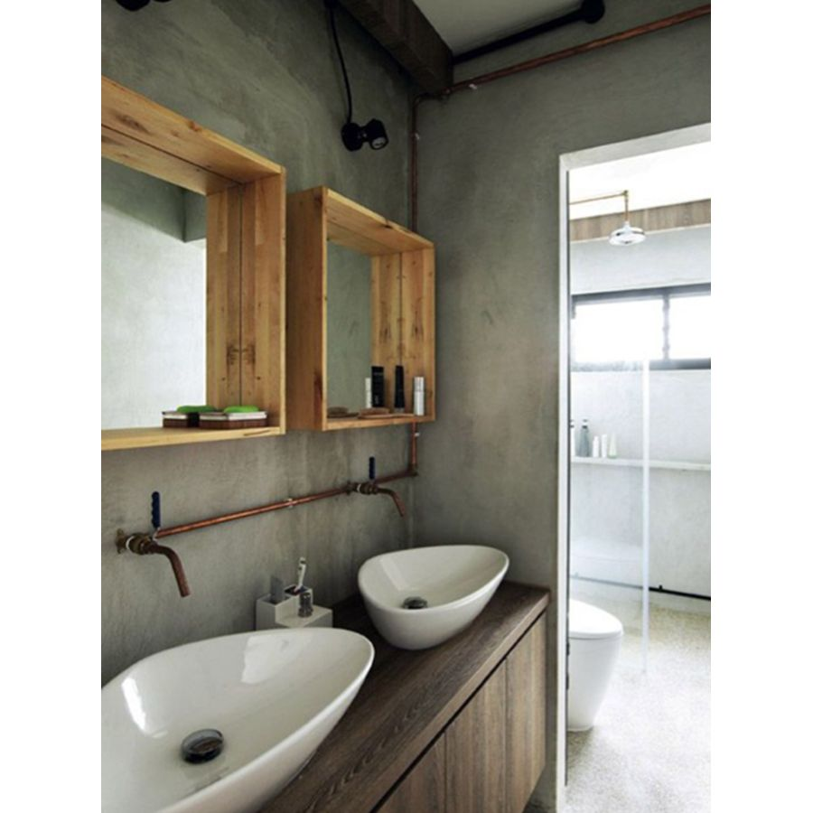 Béton et tuyaux en métal dans cette salle de bains industrielle