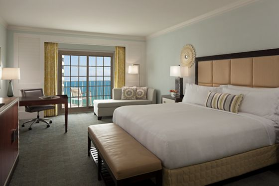 Coastal View Guest Room with a king bed, desk, chaise lounge and balcony