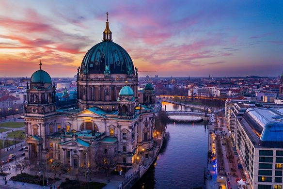 A large domed cathedral in Berlin overlooks urban waterways