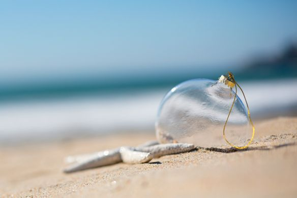 Glass ornament on the sand
