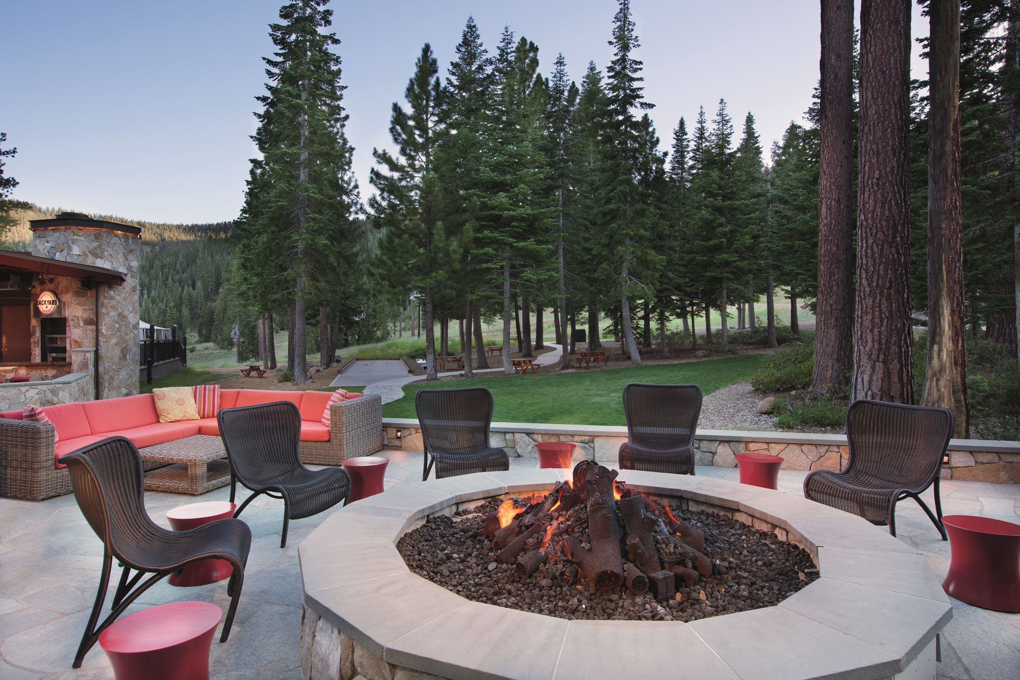 Chairs surround an outdoor fireplace