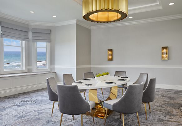 Room with ocean views and an oval meeting table