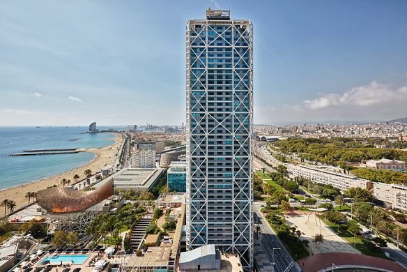 A tall building overlooking the sea