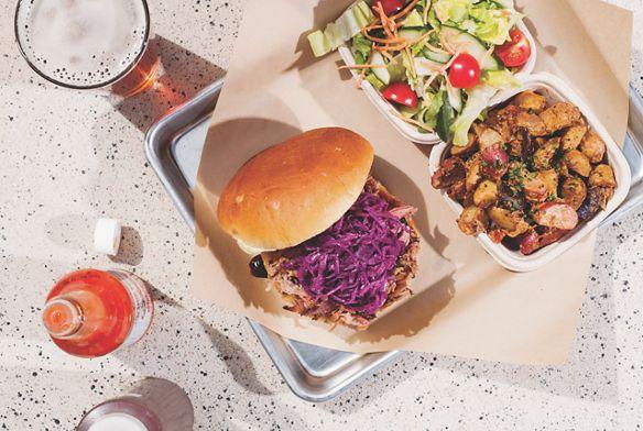 A tray with a burger and salad at Backyard BBQ in Lake Tahoe