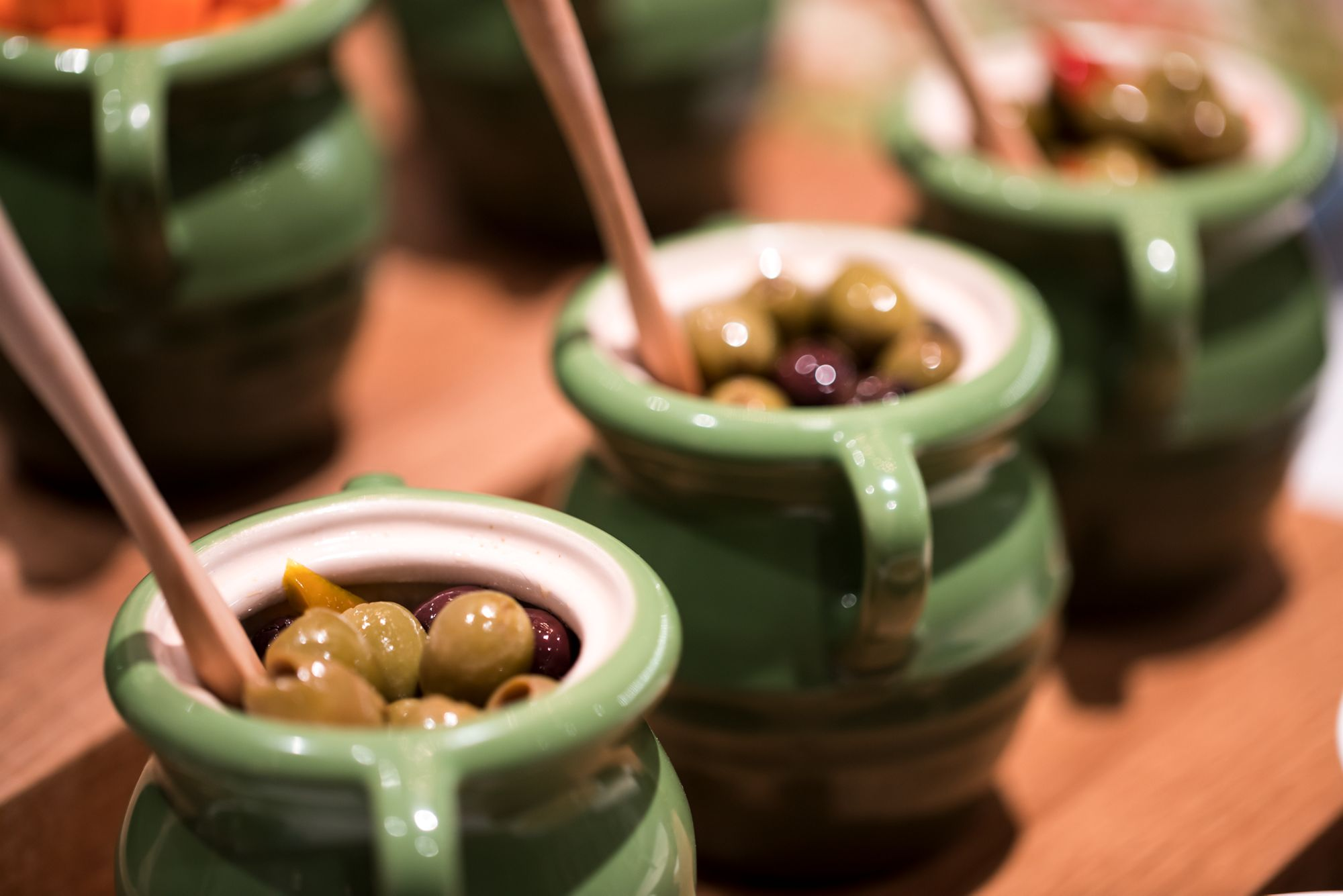 Ceramic pots filled with pitted olives