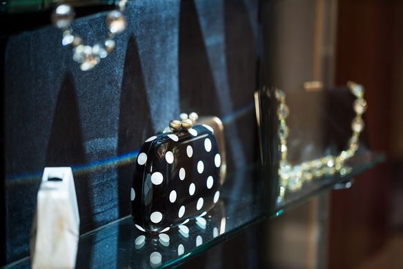 Evening handbags in a glass case