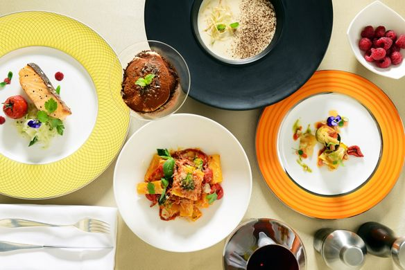 Looking down at plates and bowls showcasing a variety of dishes