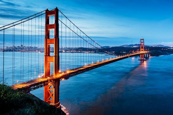 Large bridge illuminated at night