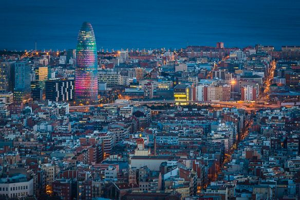 The Barcelona skyline lights up the night.