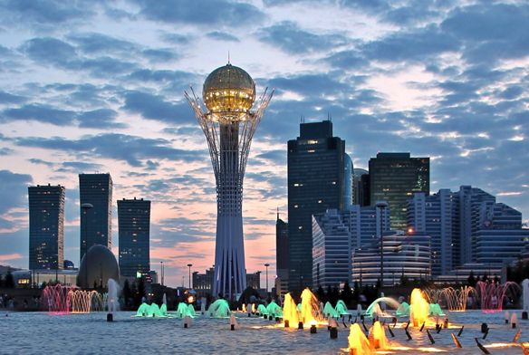 New centre of Astana capital city of Kazakhstan with landmark Baiterek tower at sunset