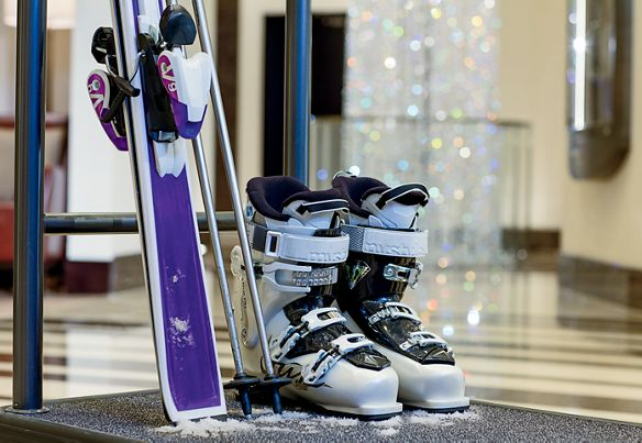A pair of ski boots and skis
