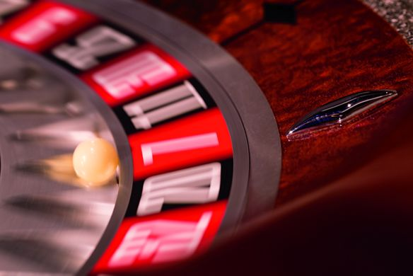 A ball spins on a roulette wheel